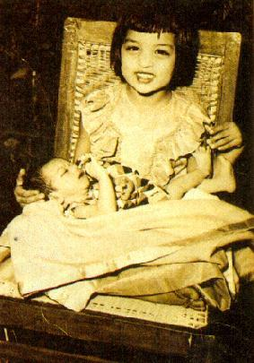 His elder sister holding SRK for the first time