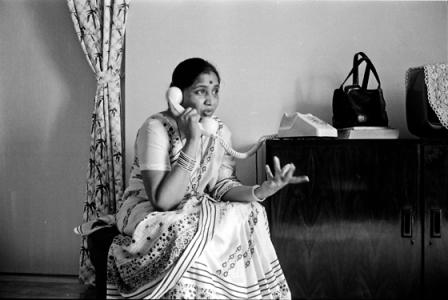 Asha B on phone 1