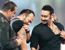 Rohit Shetty with his 'Singham' hero Ajay Devgn