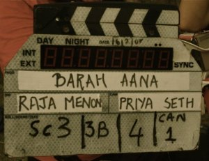 The slate of the film Barah Aana