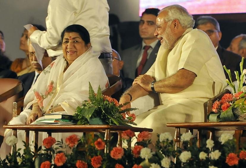 BJP prime ministerial candidate Narendra Modi felicitates singer Lata Mangeshkar on completion of 51 years since the singing of song  ``Ae Mere Vatan Ke Logo`` in Mumbai on Jan. 14, 2014.  (Photo : Sandeep Mahankal/IANS)