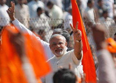 Narendra Modi gestures after taking his oath as chief minister during a swearing-in ceremony in Ahmedabad