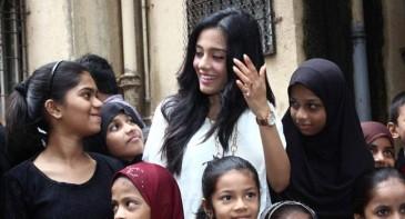 Kids interacting with Amrita Rao