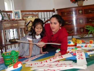 meenakshi with her daughter at home