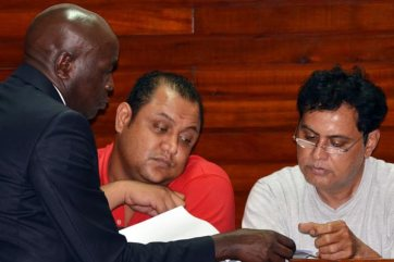 Defence lawyer Cliff Ombeta (left) with Mr Baktash Akasha Abdalla (centre) and Mr Vijaygiri Anandgiri Goswami at the Mombasa Law Courts on November 11, 2014. PHOTO | KEVIN ODIT |  NATION MEDIA GROUP