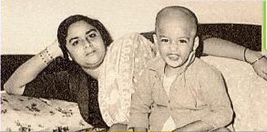 With his mother when he was one