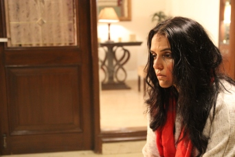 Neha Dhupia in a scene from Moh Maya Money