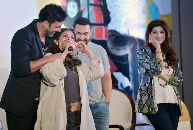 "Akshay Kumar jokingly tries to gag his mother-in-law Dimple Kapadia at Twinkle Khanna's book launch. (Picture used for representation of the word ""Bollywood"" and has no connection with the blog content)"