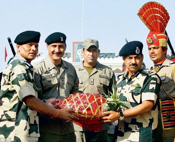 The BSF presents a sweets basket to Pakistani Rangers on the occasion of Eid-ul-Zuha at Wagha Border in Amritsar. Courtesy Daily Mail and PTI. Dated: August, 2013
